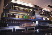Close up on bar with bottle in a line — Foto de Stock