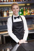 Pretty waitress smiling at the camera — Stock Photo