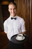 Waiter holding tray with coffee cup — Stock Photo