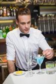 Bartender preparing a drink at bar counter — Stock Photo