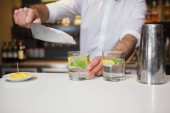 Happy bartender making a cocktail — Stock Photo