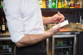 Waiter taking order in his notepad — Stock Photo
