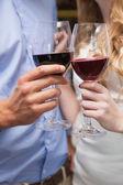 Close up of lovely couple enjoying red wine — Stock Photo