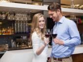 Lovely couple enjoying red wine — Stock Photo