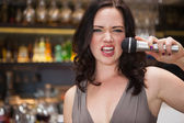Pretty brunette singing with her microphone — Stock Photo