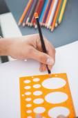 Designer drawing circle on paper — Foto de Stock