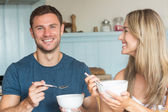Cute couple having cereal for breakfast — Stock Photo