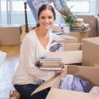 Cute couple unpacking cardboard boxes — Stock Photo #60825221
