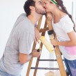 Cute couple redecorating living room — Stock Photo #60825417