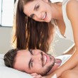 Young couple having fun in bed — Stock Photo #60826391