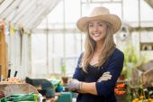 Pretty blonde smiling in greenhouse — Stock Photo