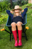 Pretty blonde napping in wheelbarrow — Stock Photo