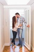 Cute couple walking through the door — Stock Photo