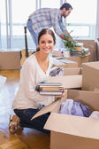 Cute couple unpacking cardboard boxes — Stock Photo