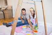 Cute couple about to paint living room — Stock Photo