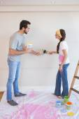 Cute couple painting the wall — Stock Photo