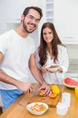 Young couple preparing a healthy breakfast — Stock Photo