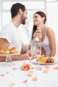 Young couple having a romantic breakfast — Stock Photo