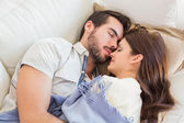 Cute couple napping on couch — Stock Photo