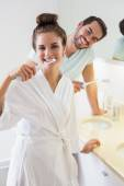 Young couple brushing their teeth — Stock Photo