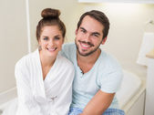 Young couple smiling at the camera — Stock Photo