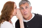 Woman telling secret to her partner — Stock Photo