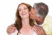 Man giving his partner a kiss — Stock Photo