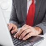 Mature businessman using his laptop — Stock Photo #60832093