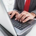 Mature businessman using his laptop — Stock Photo #60832097