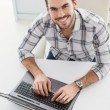 Casual businessman using his laptop at desk — Stock Photo #60832667