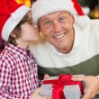 Son kissing his father after receiving a christmas gift — Stock Photo #60833511