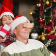 Son surprising his father with christmas gift — Stock Photo #60833521