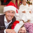 Festive father and son opening christmas present — Stock Photo #60836147