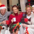 Happy extended family enjoying coffee at christmas time — Stock Photo #60837005