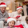 Happy family opening christmas gifts together — Stockfoto #60837093