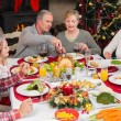 Three generation family having christmas dinner together — Stock Photo #60837925