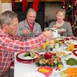Three generation family having christmas dinner together — Stock Photo #60837961