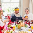 Family in party hat having fun at christmas time — Stock Photo #60838503