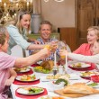 Three generation family enjoying christmas dinner together — Stock Photo #60838755