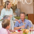 Pretty family speaking together at christmas dinner — Stock Photo #60838761