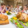 Family saying grace before christmas dinner together — Stock Photo #60838809