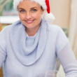 Portrait of pretty young woman in santa hat smiling — Stock Photo #60838957