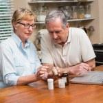 Senior couple looking up medication online — Stock Photo #60839255