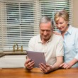Senior couple looking at tablet pc together — Stock Photo #60839457