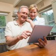 Senior couple looking at tablet pc together — Stock Photo #60839461