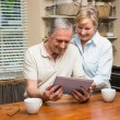 Senior couple looking at tablet pc together — Stock Photo #60839469