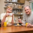 Senior couple having breakfast together — Stock Photo #60839665
