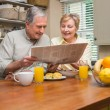 Senior couple having breakfast together — Stock Photo #60839687