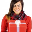 Smiling brunette holding a gift with white bow — Stock Photo #60839899