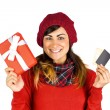 Happy brunette holding gift and cards — Stock Photo #60839935